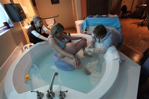 water birth in bathtub using the kaya birth stool in the tub labor and