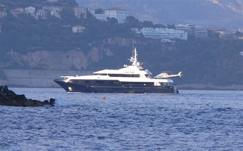 yacht with helicopter superyacht and helicopter entering port monaco