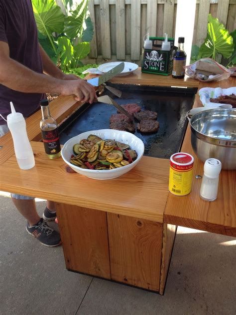grillin burgers on a summer day backyard hibachi