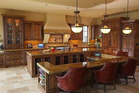 Kitchen is thoroughly dominated by multi part island with full height