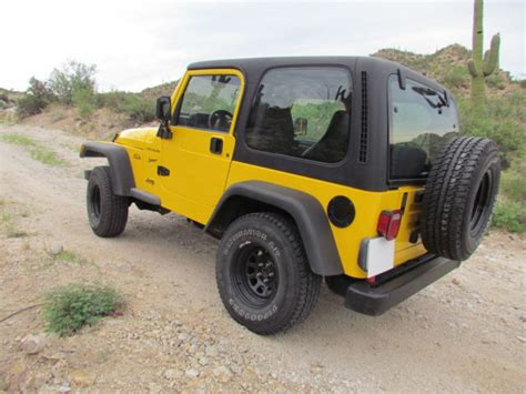 yellow jeep 4 door 1j4fy19s6xp432049 1999 jeep wrangler sport 2 door yellow