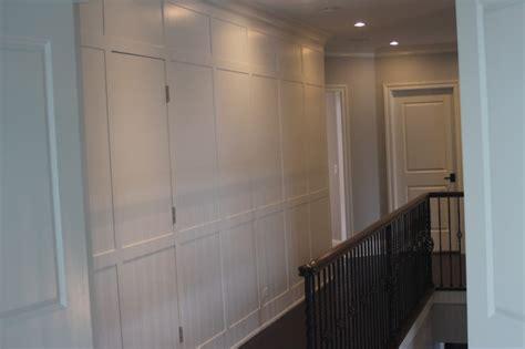 Wainscot Wall With Hidden Door Wainscoting Cabinet Doors