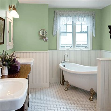 mosaic tile tongue and groove wainscoting and a vintage