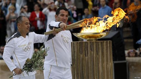 Lighting Olympic Torch by News 2012 Olympic Handover Ceremony