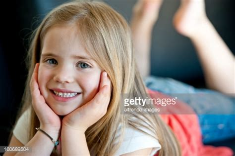 very young tube stock photos and pictures getty images portrait of young girl lying down smiling stock photo