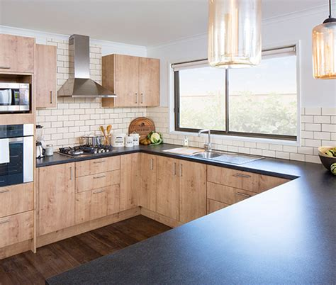 kitchens with black bench tops black toffee kitchen benchtop kaboodle kitchen