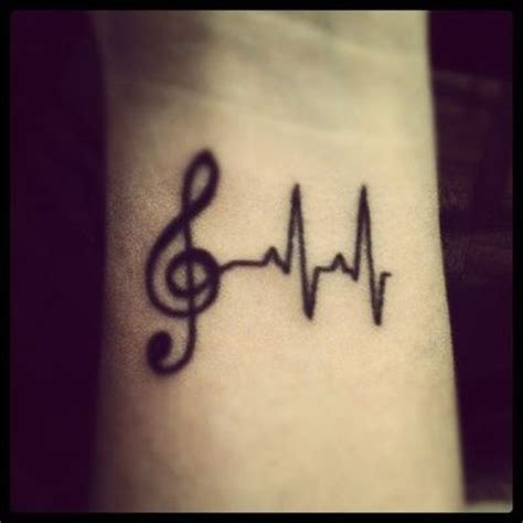 tattoo design rates wrist tattoo black ink treble clef heart rate monitor