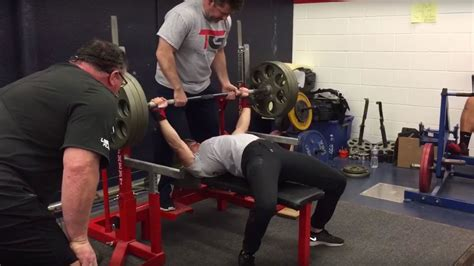 insane bench press watch this woman bench press 325 pounds in front of an entire college football team self