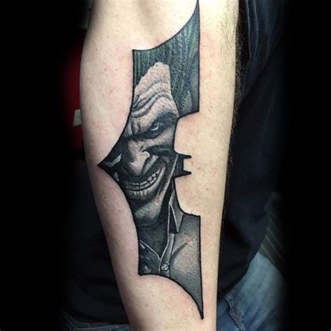 batman logo tattoo arm batman symbol shaped black ink arm tattoo stylized with