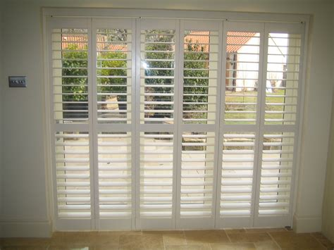 plantation shutters with drapes plantation shutters russells creative curtains and