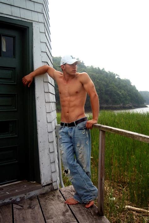 hunk in blue jeans barefoot