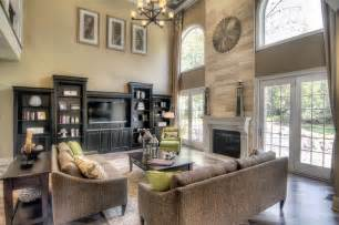 Great Room Windows Inspiration Two Story Great Room With Windows Doors Beside Fireplace And Entertainment Wall Family Room