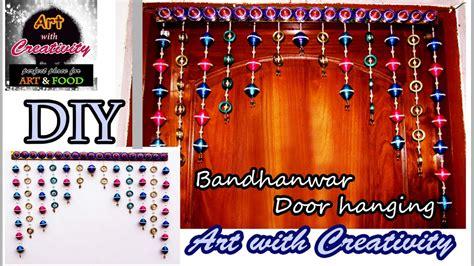 How To Make Toran With Paper - newspaper wall hanging bandhanwar door hanging toran