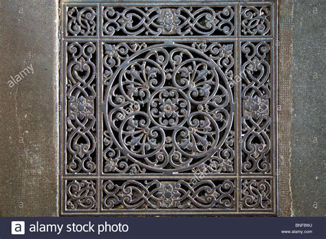 decorative metal l decorative metal floor grate on the floor of a church in