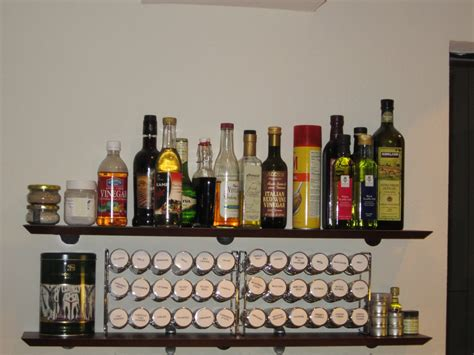 What Is The Shelf Of Bottled by A Jones For Organizing Storing A Lot Of Spices In A Small Wall Space A Jones For Organizing