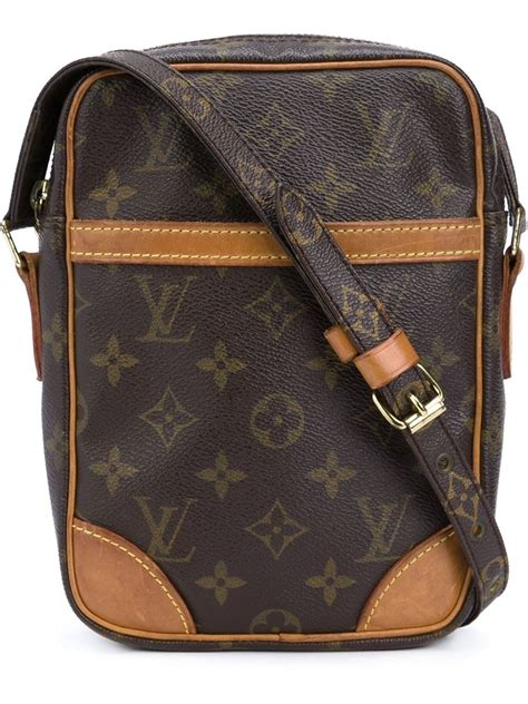 louis vuitton danu monogrammed cross body bag  brown lyst