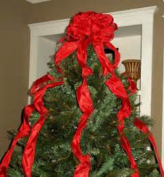 red christmas tree topper bow with streamers by
