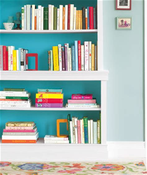 borrow a trick from interior designers inside a bookcase use paint that s a shades