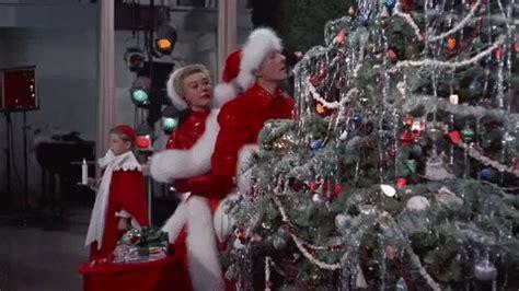 gif white christmas christmas movies kiss animated gif  gifer
