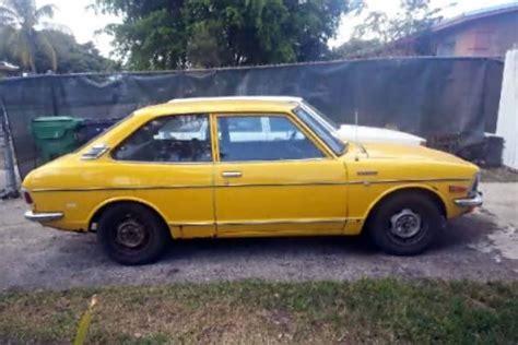 yellow toyota corolla plain yellow 1973 toyota corolla