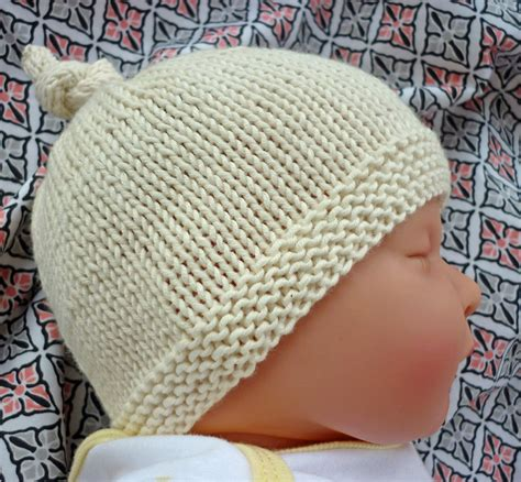 baby hats to knit with circular needle lovefibres tegan baby hat with top knot pattern