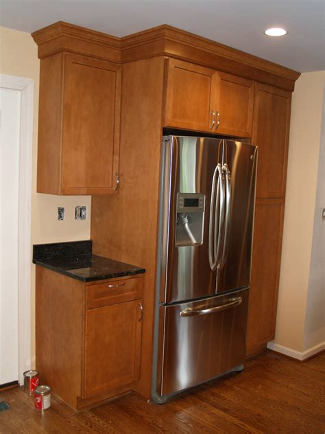 kitchen cabinets around refrigerator the cabinets