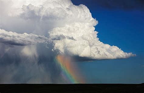 wallpaper awan cumulonimbus cumulonimbus cloud over sheets of rain rainbow colo