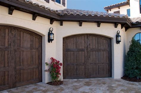 Garage Doors Styles And Prices Our Faux Wood Carriage House Style Garage Doors Add Curb Appeal To This Florida Mediterranean
