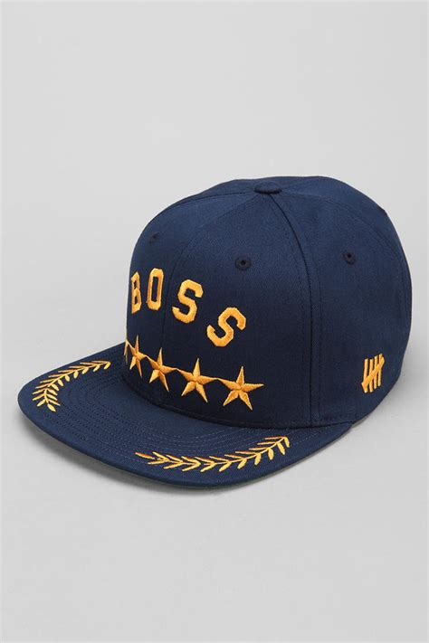 lyst undefeated snapback hat in blue for