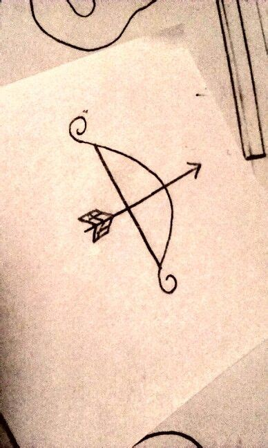 sagittarius tattoo behind ear want a bow and arrow for my love of archery and