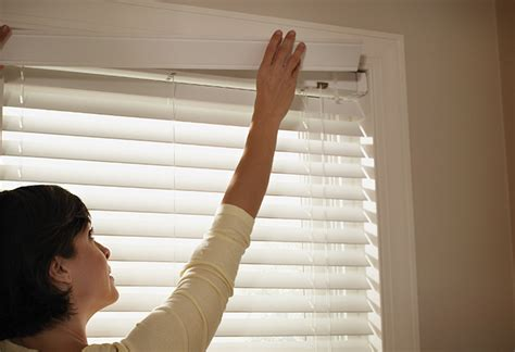 how to hang window treatments how to install a horizontal blind at the home depot