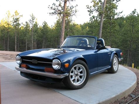 low cost lotus 7 triumph tr 6 this is a gorgeous photograph of an iconic