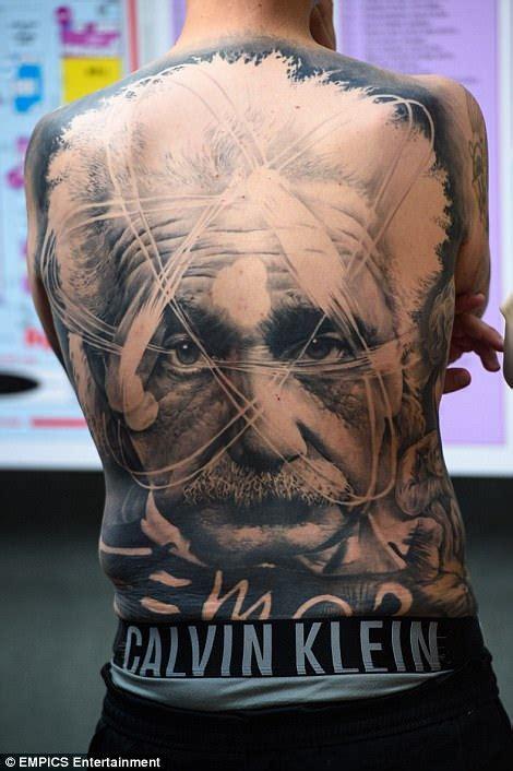 flash tattoo in london revellers attend international london tattoo convention