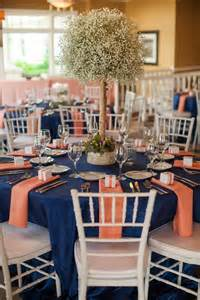 Navy and coral tablescape with baby s breath shared on wedding