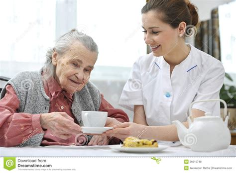 senior with home caregiver stock photo image 36610748