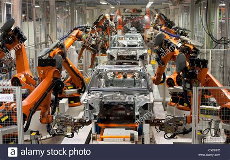 audi production line industrial robots putting out car bodies on assembly line