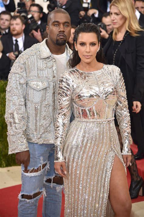 2016 balmain with kanye west from kim kardashian s met gala looks through the years e news met gala 2016 kim kardashian and kanye west in balmain tom lorenzo