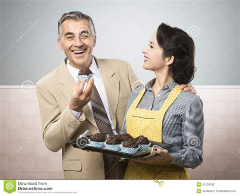 gender stereotypes in advertising bates30 vintage woman cooking muffins for her husband stock photo
