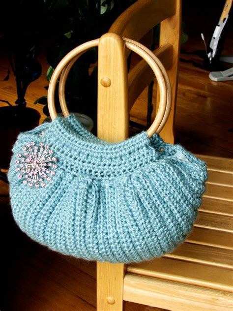 crochet bag bottom pattern crochet fat bottom bag with cane handles with pink brooch
