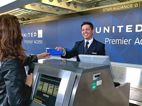 check in united airlines united slashes business class baggage limits adds 200