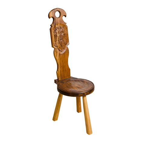 Spinning In A Chair by Spinning Chair With Green Carving