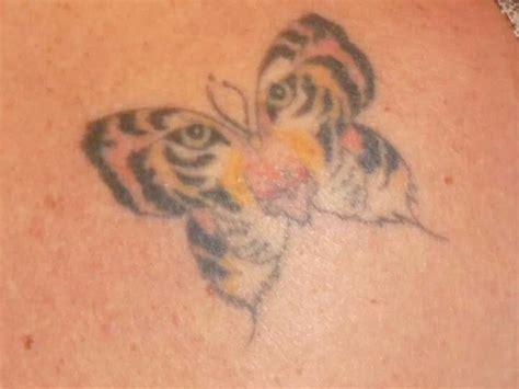 vertigo tattoo tiger in butterfly shape vertigo outer banks