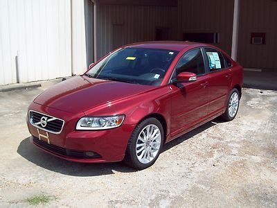 buy  red  volvo   door turbo  sedan  miles leather interior bucket seats