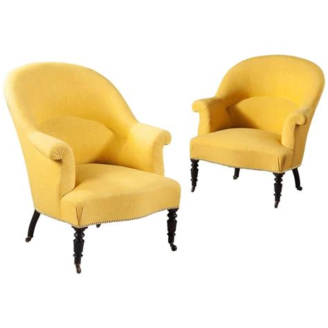 pair of antique yellow and black bergeres tub