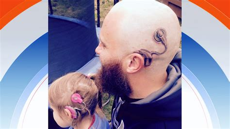 father gets tattoo to support daughter with cochlear