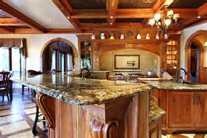 Kitchens With 2 Islands large elegant kitchen with wood and granite countertop bar