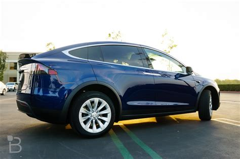 tesla model x falcon wing doors explained