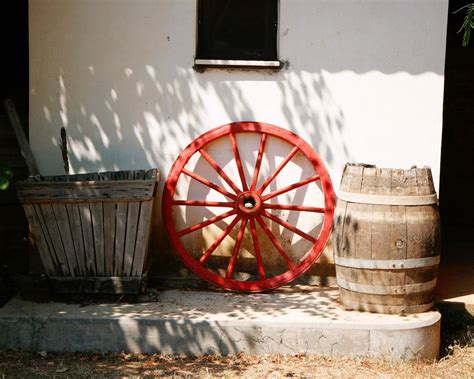 wagon wheel home decor rustic home decor red wagon wheel photograph by vitanostra