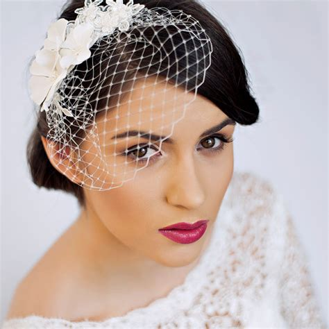 wedding hair with small veil small birdcage veil with cherry blossom in ivory bridal