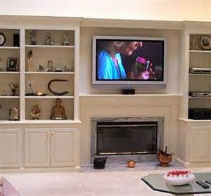 bookshelves around tv custom made bookcases and fireplace with plasma tv by